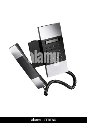 A modern stylish land line telephone as a cut out - Stock Image