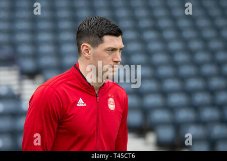 Hampden Park, Glasgow, UK. 14th Apr, 2019. Scottish Cup football, semi final, Aberdeen versus Celtic; Scott McKenna of Aberdeen inspects the pitch before the match Credit: Action Plus Sports/Alamy Live News - Stock Image