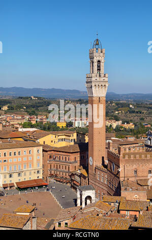Siena, Italy. Torre del Mangia - famous bell tower located on the city's premier square Piazza del Campo - Stock Image