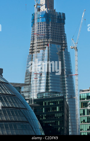 The Shard building under construction seen to the rear of the City Hall. London. England. - Stock Image