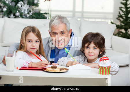 Grandfather And Children With Cardpapers - Stock Image