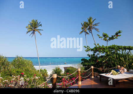 Zanzibar, Matemwe Bungalows. A guest relaxes on her sunbed, overlooking the private beach. MR. - Stock Image