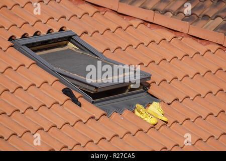 Outdoor Shoe Rack . original shoe rack above a roof - Stock Image