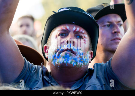 A Rag 'n' Bone fan with painted face at Latitude Festival 2018. - Stock Image
