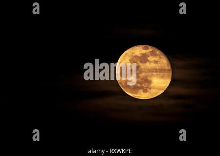 The moon just after rising in the East in the night sky in Northampton, uk. - Stock Image