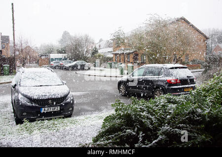 Snow falling in cul-de-sac, Stanwell Moor, Surrey, England, United Kingdom - Stock Image