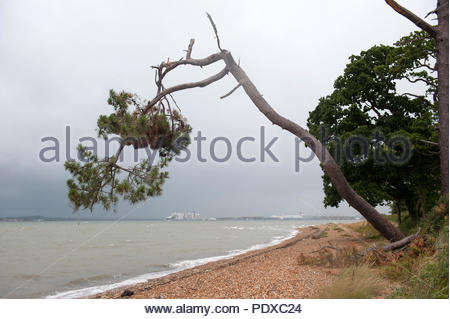 Southampton UK 10th August 2018  It never rains but it pours. After weeks of drought thunder storms with strong winds whip along the South Coast. Along Weston Shore in Southampton a dark thunder storm approaches. Further in the distance three Queens of the Cunard line are in port before departing together later in the day. Credit: Richard Wareham Fotografie/Alamy Live News - Stock Image