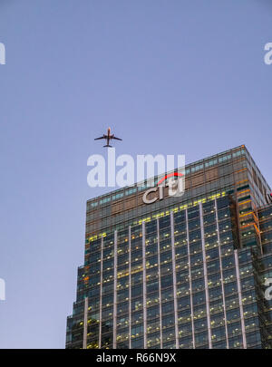 Citi building with plane flying overhead, Docklands, London, UK. - Stock Image