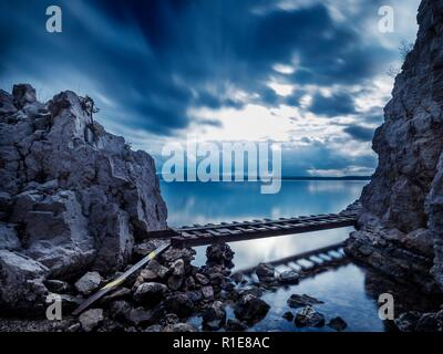 Small wooden footbridge long exposure Dirakovica Dramalj near Crikvenica in Croatia - Stock Image