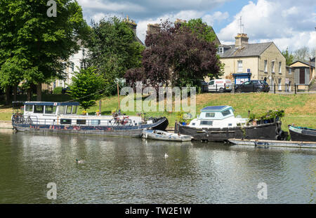 Boats moored along river Cam opposite Jesus Green Cambridge 2019 - Stock Image