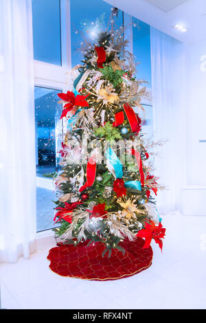 A beautiful Christmas tree in the lobby of an upscale condo on Fort Lauderdale Beach. - Stock Image