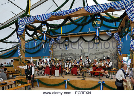 Band plays music in Festzelt (pavillion, marquee) at Oktoberfest 2010, celebrating 200th anniversary of King Ludwig - Stock Image