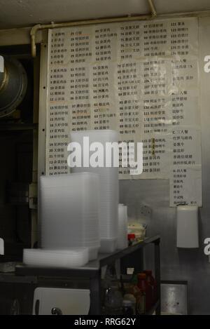Mandarin Chinese language menu in Chinese takeaway kitchen. - Stock Image
