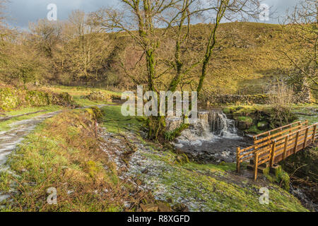 Waterfall and Footbridge, Ettersgill Beck, Teesdale in Winter Sunshine - Stock Image