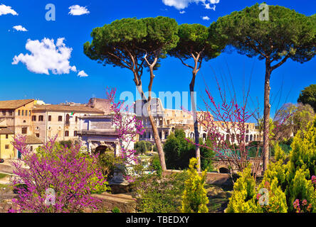 Scenic springtime panoramic view over the ruins of the Roman Forum and Colosseum in Rome, capital of Italy - Stock Image