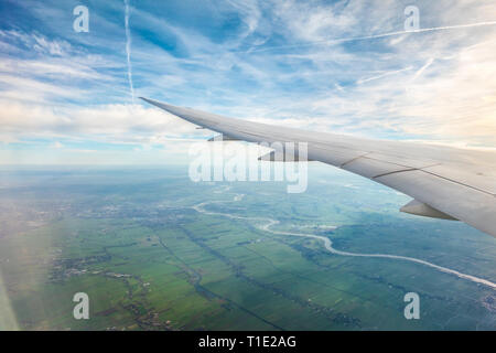 Jet airplane aeroplane plane trails contrails or Cirrus Aviaticus over Holland from the window of a Boeing 787 8 Dreamliner - Stock Image