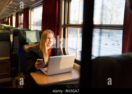 Young woman in train - Stock Image