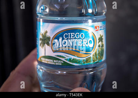 'Ciego Montero' brand name on a Cuban bottle of water. The brand is marketed by Nestle - Stock Image