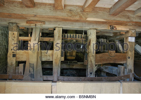 Inside Lurgashall Water Mill showing the mechanism. - Stock Image