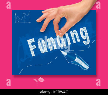 A hand picking up a Funding concept on a colorful drawing board - Stock Image