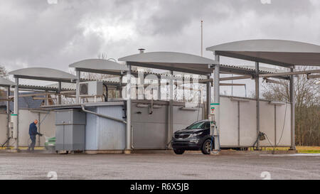 Environmentally friendly car washing facility with person washing car - Stock Image