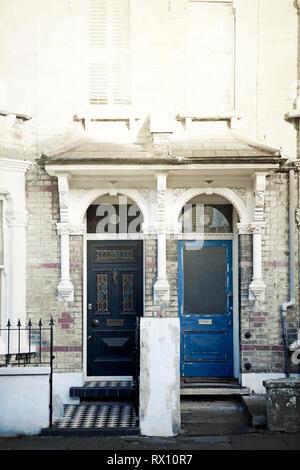 Two Door fronts Alongside in London UK - Stock Image