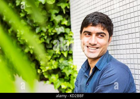 Portrait of cheerful man - Stock Image