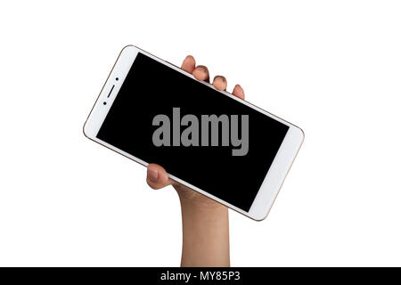 Closeup of a child's hand holding a large screen smartphone isolated on white background - Stock Image