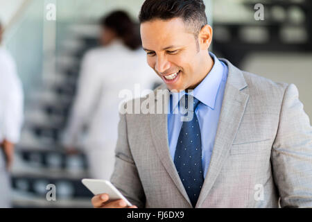 professional businessman using smart phone in office - Stock Image