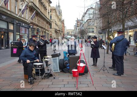 Salvation Army band entertaining Christmas shoppers on Buchanan Street precinct, Glasgow, Scotland, UK, Europe - Stock Image
