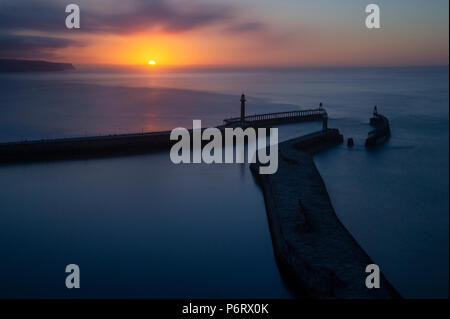 A summer sunset over Whitby Harbour on the North Yorkshire coast - Stock Image