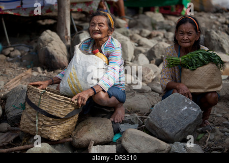 Elder Hanunoo Mangyan women at rest while attending a Mangyan market near Mansalay, Oriental Mindoro, Philippines. - Stock Image