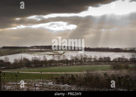 The Old Bures Dragon in a snow covered field. The Chonicles of St Albans Abbey describe how a huge dragon destroyed and killed sheep. unsharpened - Stock Image