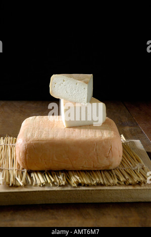 Soft cheeses in rustic setting - Stock Image