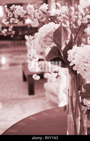 Wedding flowers arranged floral bouquet in marriage luxury 5 star hotel reception room. - Stock Image