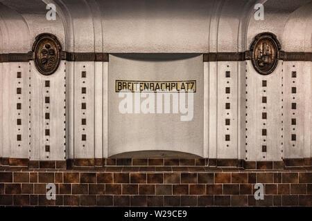 Berlin Dahlem District,Breitenbachplatz U-Bahn underground railway station interior, decorative tiles, medallions & station name. - Stock Image