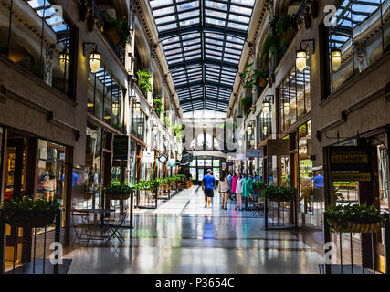 ASHEVILLE, NC, USA-10 JUNE 18:  A hallway inside the Grove Arcade, featuring a variety of small shops. - Stock Image