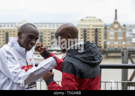 London,UK,24th April 2019,Eliud Kipchoge(Ken) and Sir Mo Farah attend The London Marathon Elite Mens Photocall which took place outside the Tower Hotel with Tower Bridge in the background ahead of the Marathon on Sunday.Credit: Keith Larby/Alamy Live News - Stock Image