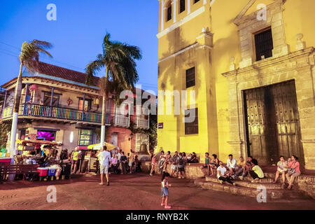 Cartagena Colombia Old Walled City Center centre Getsemani Plaza de la Trinidad Holy Trinity Square night nightlife outdoor gathering place Hispanic r - Stock Image