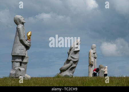 Granite sculptures at the Valley of the Saints, Quenequillec, Brittany, France. - Stock Image