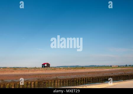 An old fisherman's hut by the beach on a fresh summer's morning - Stock Image