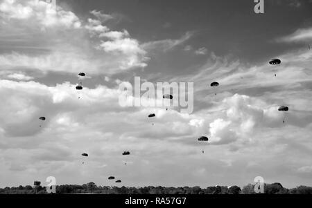 World War II era parachute drop in black and white - Stock Image