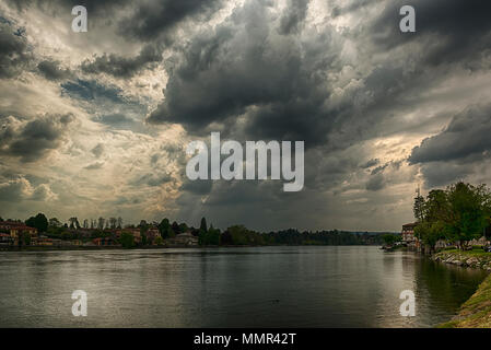 Thunderstorm formation over the river Ticino in a spring afternoon, Sesto Calende - Italy - Stock Image