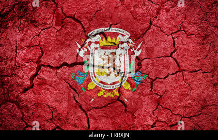 Santiago de León de Caracas flag, capital city of Venezuela, on dry earth ground texture background - Stock Image