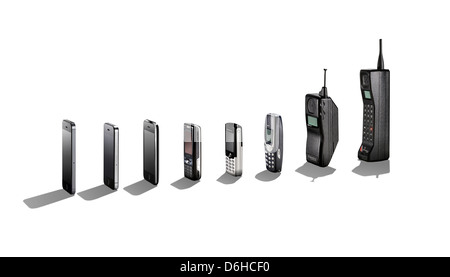 A range of mobile phones showing their evolution with shadows. - Stock Image