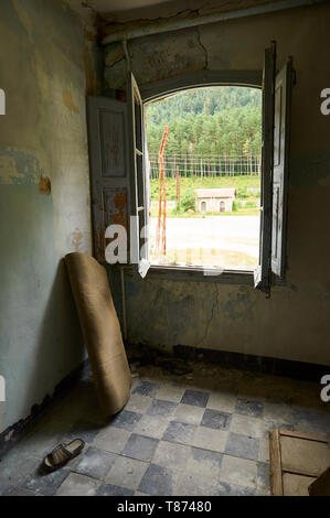 Interior of a room in the ruined facilities at the abandoned Canfranc International railway station (Canfranc, Pyrenees, Huesca, Aragon, Spain) - Stock Image