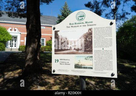 Bilingual informational board about Mt Desert Island Hospital in Bar Harbor, Maine, USA. - Stock Image