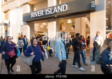 Pedestrians walking past the River Island Store, Oxford Street, London, UK, Europe, - Stock Image
