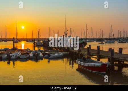 The sun rises over Vineyard Haven Harbor in Tisbury, Massachusetts on Martha's Vineyard. - Stock Image