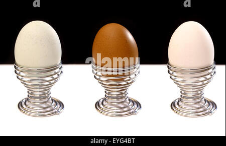 Three eggs in springy cups - Stock Image